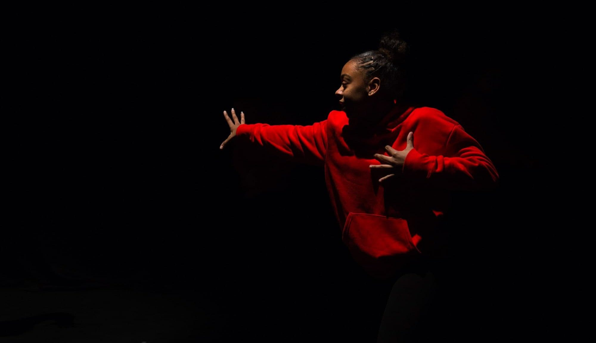 girl in red jumper performance